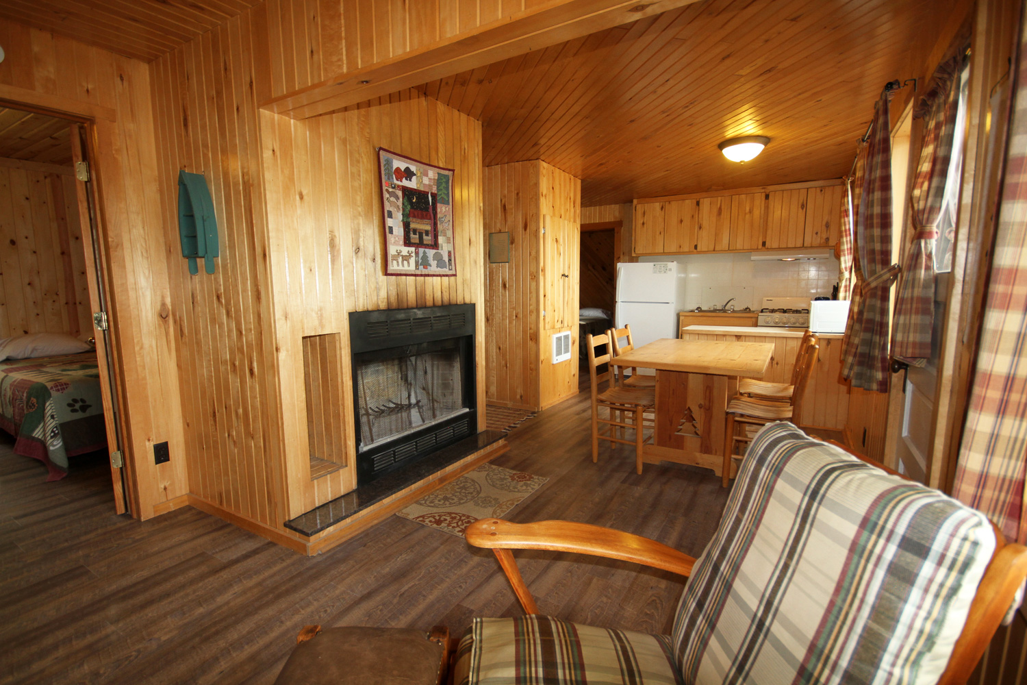 Open Living & Dining Space with centralized Fireplace & great views of the lake