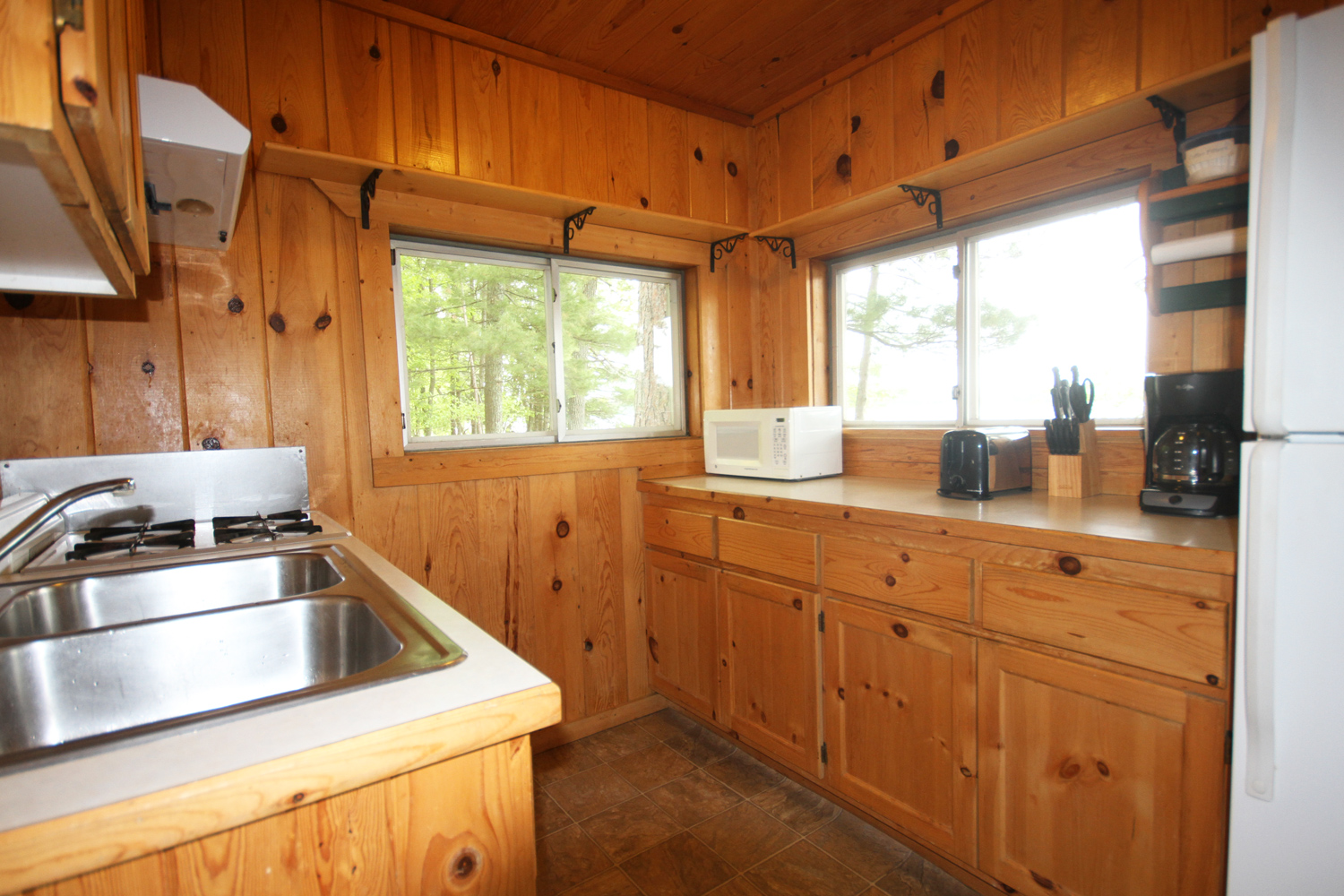 Galley Style Kitchen with View of the Lake