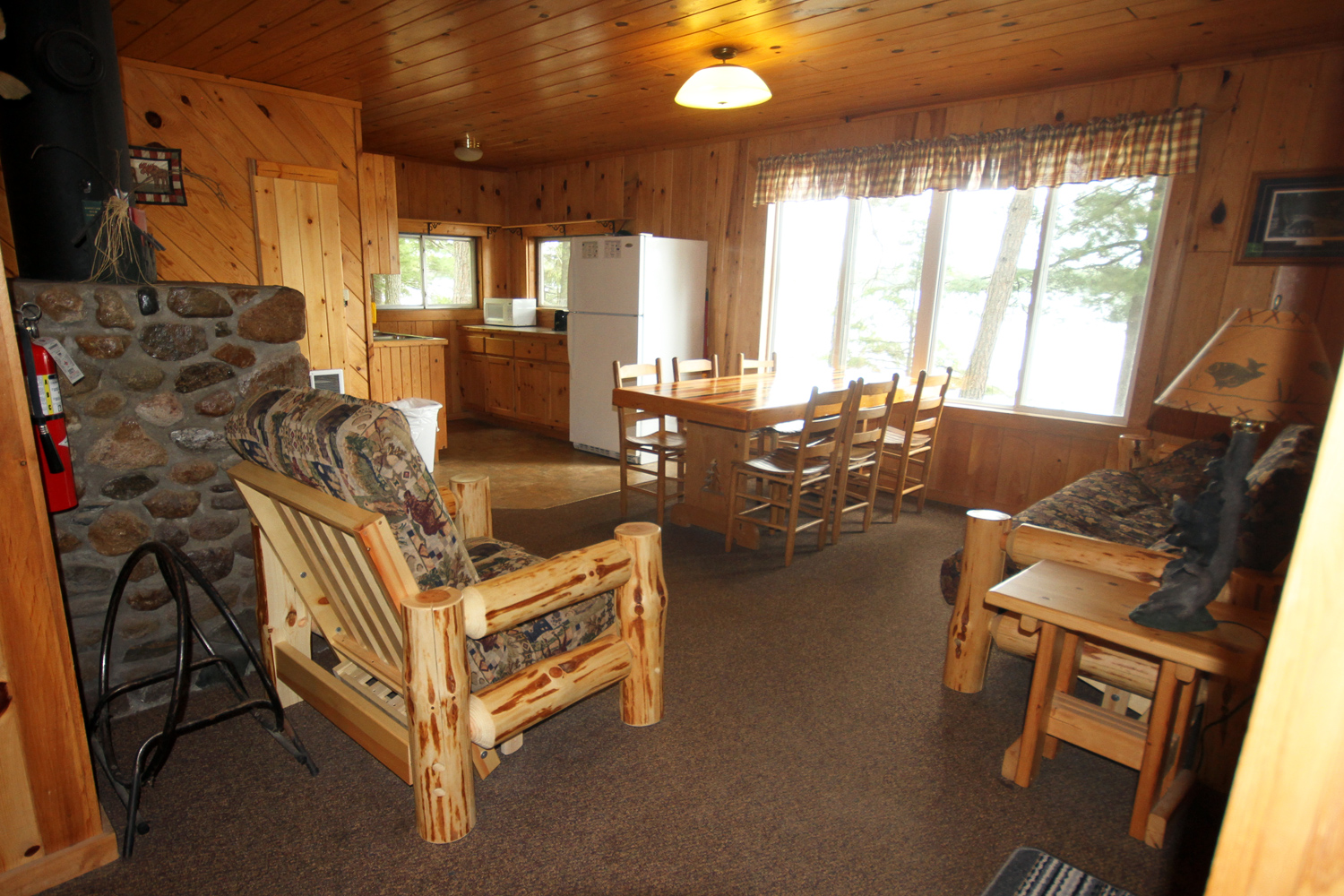 Walk into the Living & Dining Area with a Pull Out Couch & Fireplace