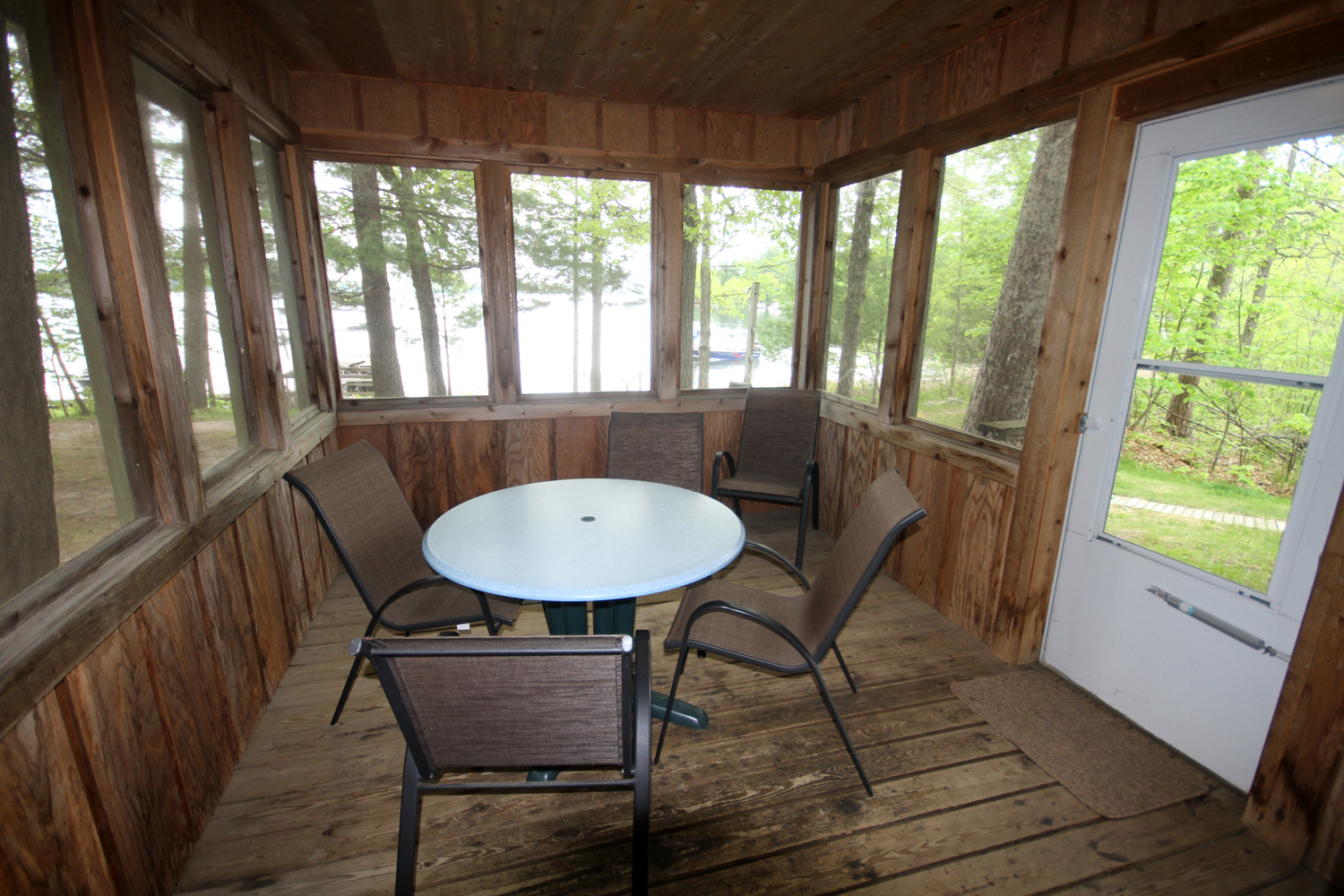 Cozy screen porch extends the living space