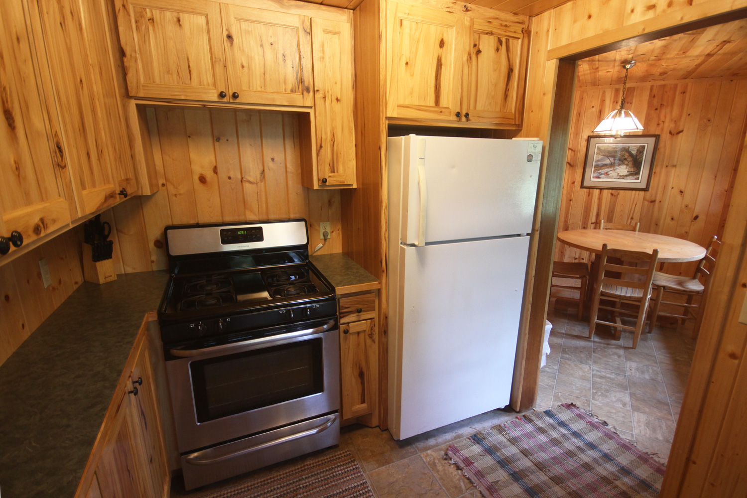 Kitchen with full size stove & refrigerator