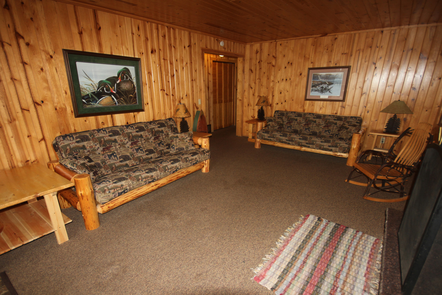 Spacious living room off the deck with pull-out couches